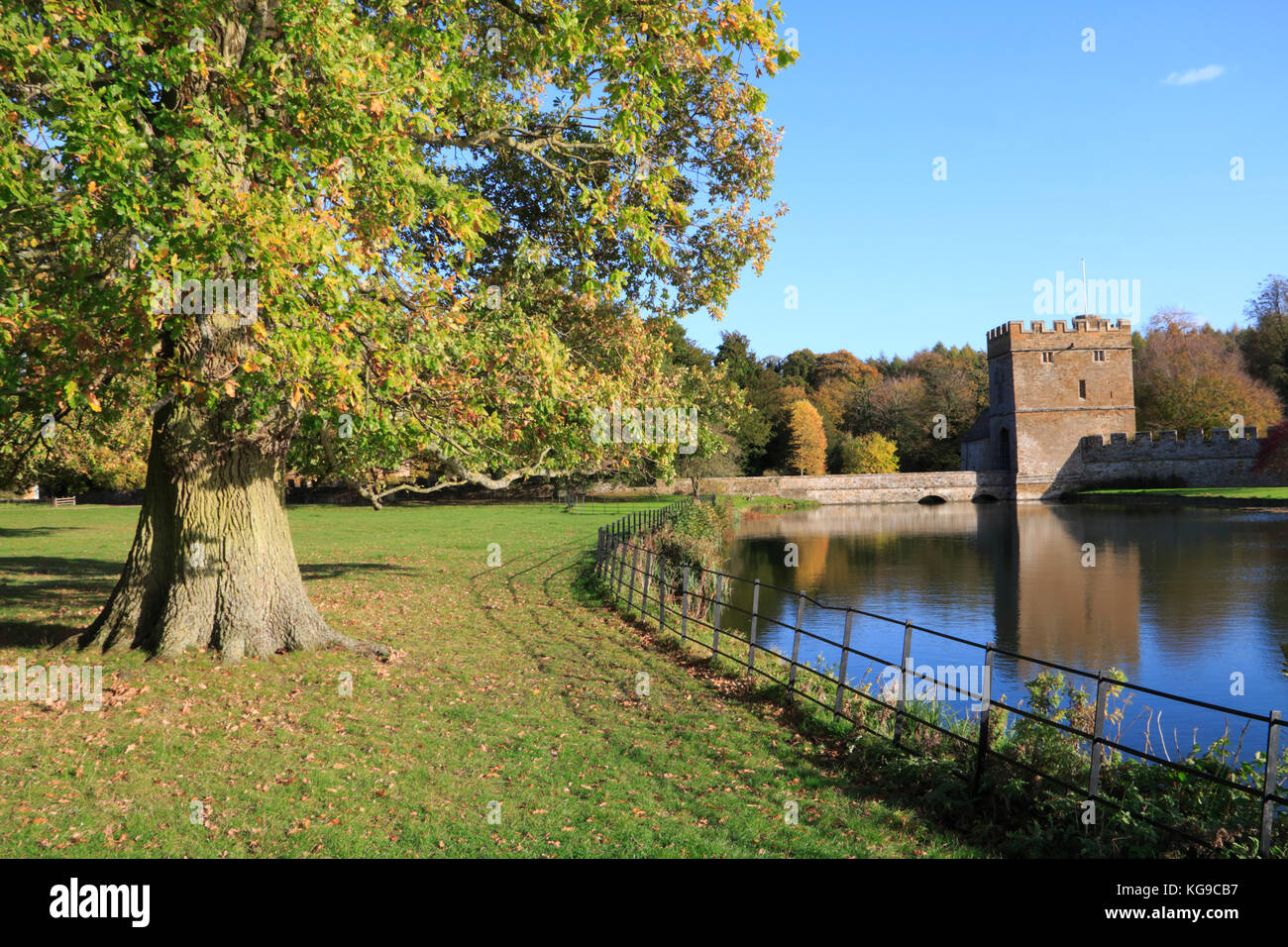 Autumn trees in the grounds of Broughton Castle near Banbury, Oxfordshire - Stock Image