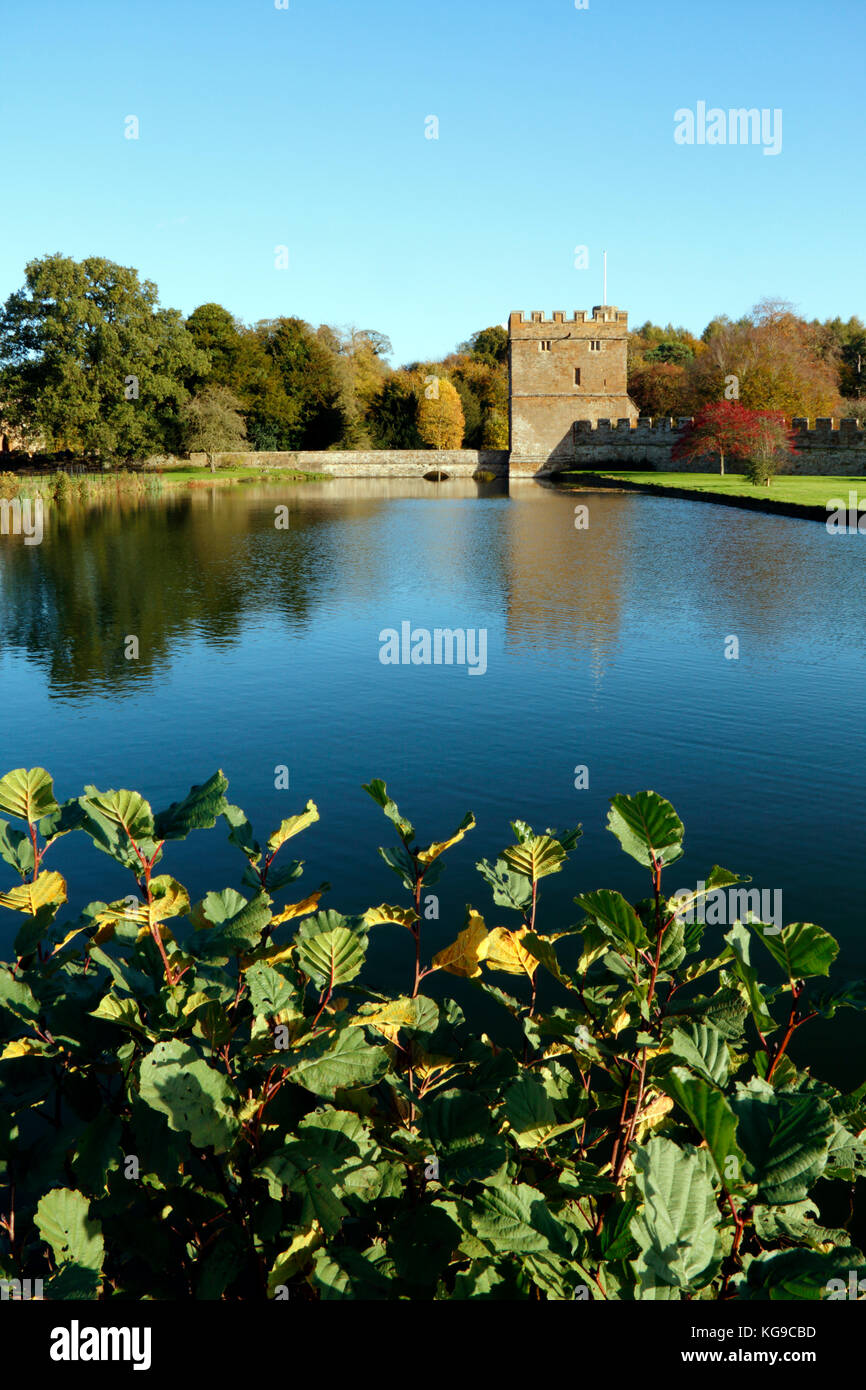 Autumn trees in the grounds at Broughton Castle near Banbury, Oxfordshire - Stock Image
