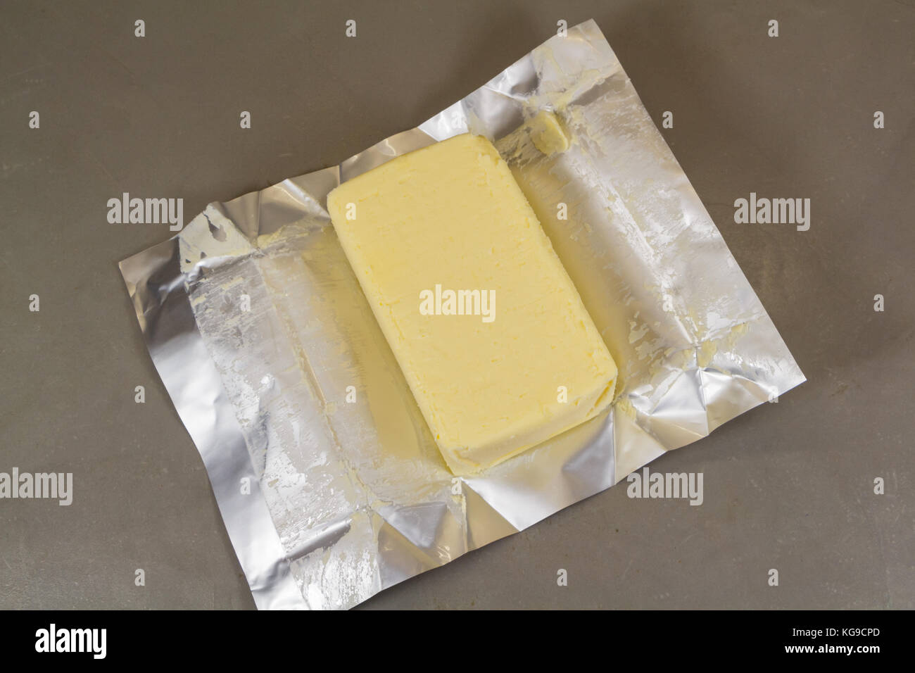Pack of salted butter unwrapped Stock Photo