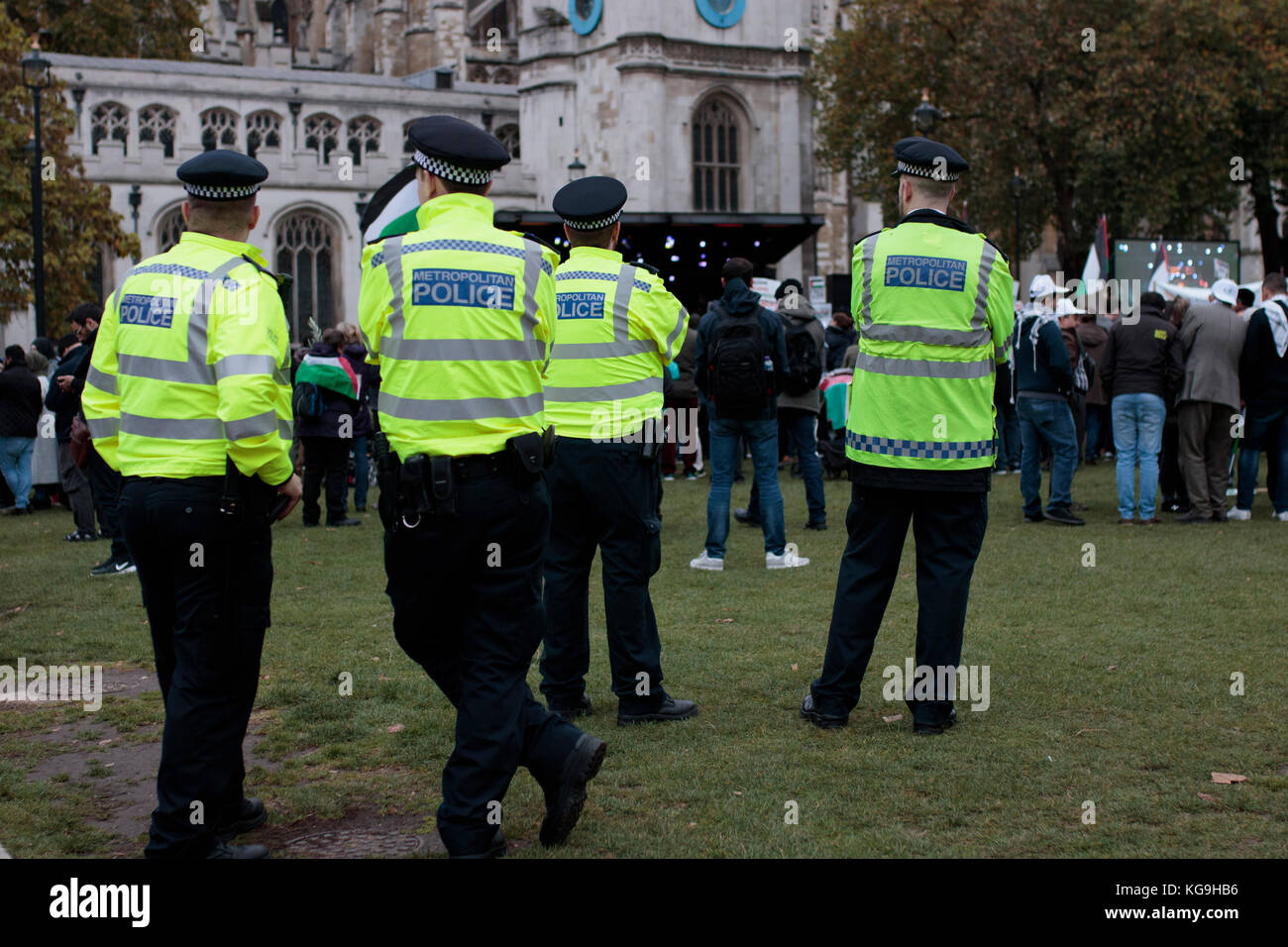 Four policemen overlooking Pro-Palestine protest, London, UK, 4th November 2017 - Stock Image