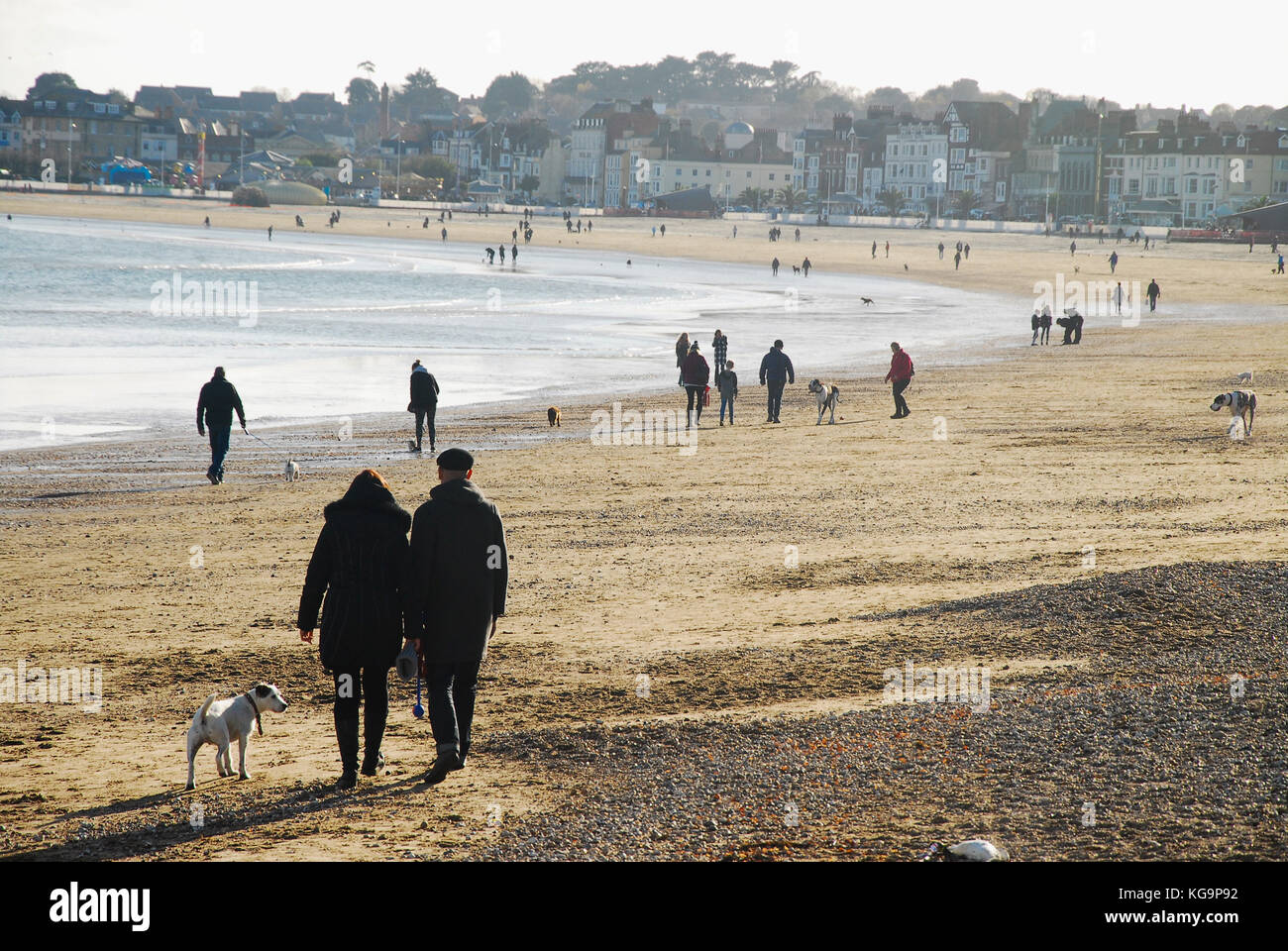 Weymouth, Dorset. 5th November 2017 - People wrap up warm and make the most of a gorgeous autumn day, strolling - Stock Image