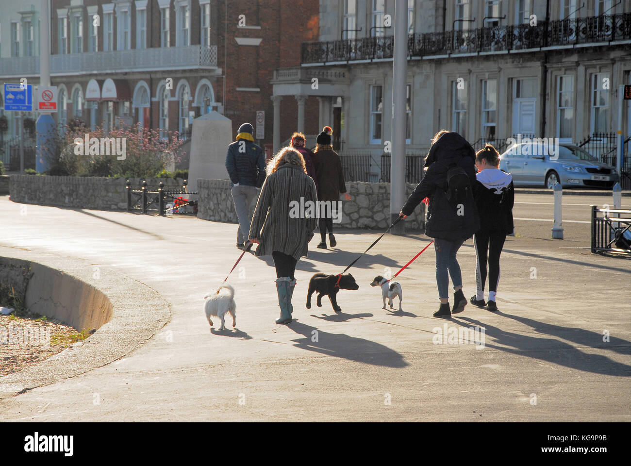 Weymouth, Dorset. 5th November 2017 - People wrap up warm and make the most of a gorgeous autumn day by walking - Stock Image
