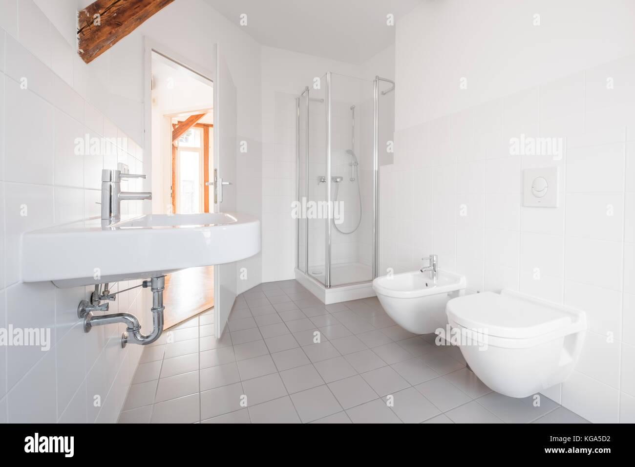 modern bathroom - white tiled bath with shower Stock Photo ...