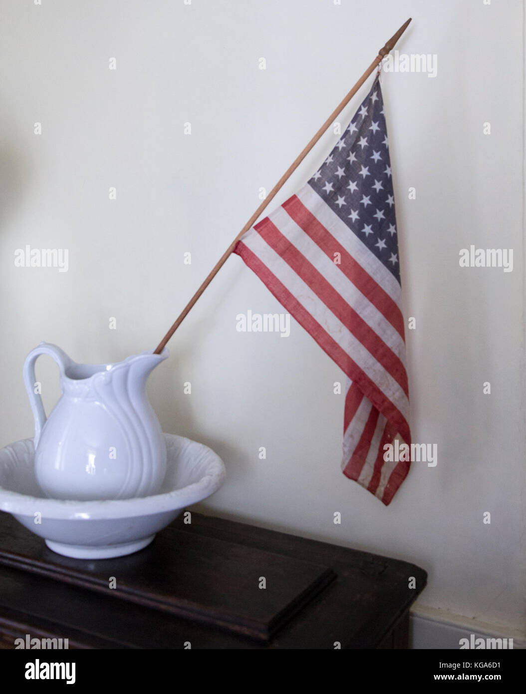 An American flag and a pitcher and bowl at at the Hopper-Goetschius house museum in Upper Saddle River, New Jersey - Stock Image