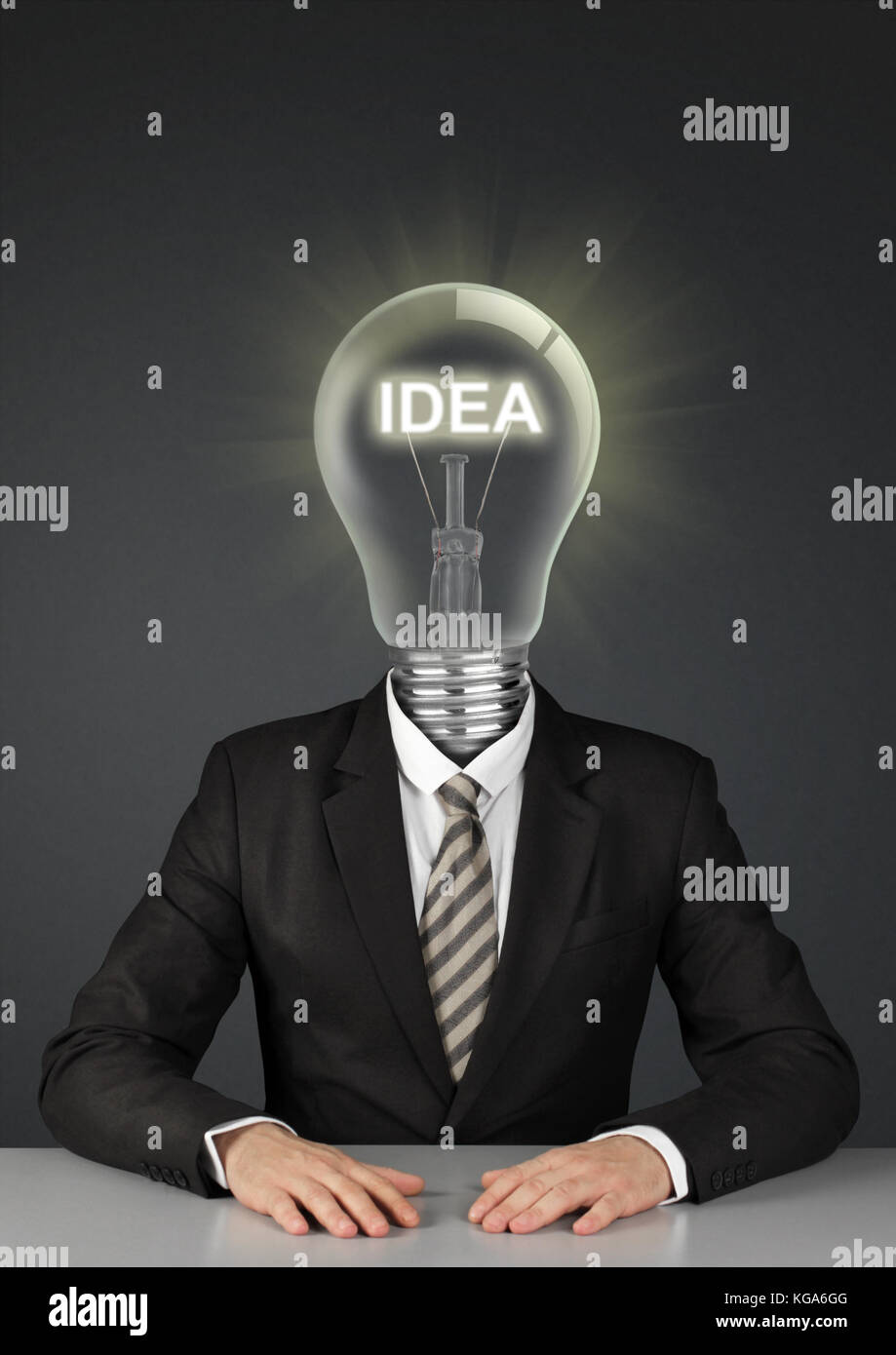 Businessman on black with light bulb instead of head, great ideas concept - Stock Image