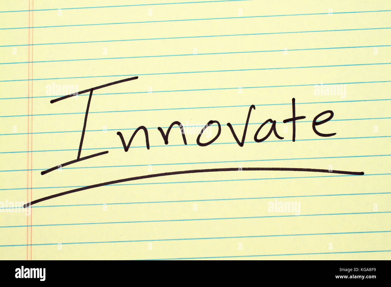 The word 'Innovate' underlined on a yellow legal pad - Stock Image