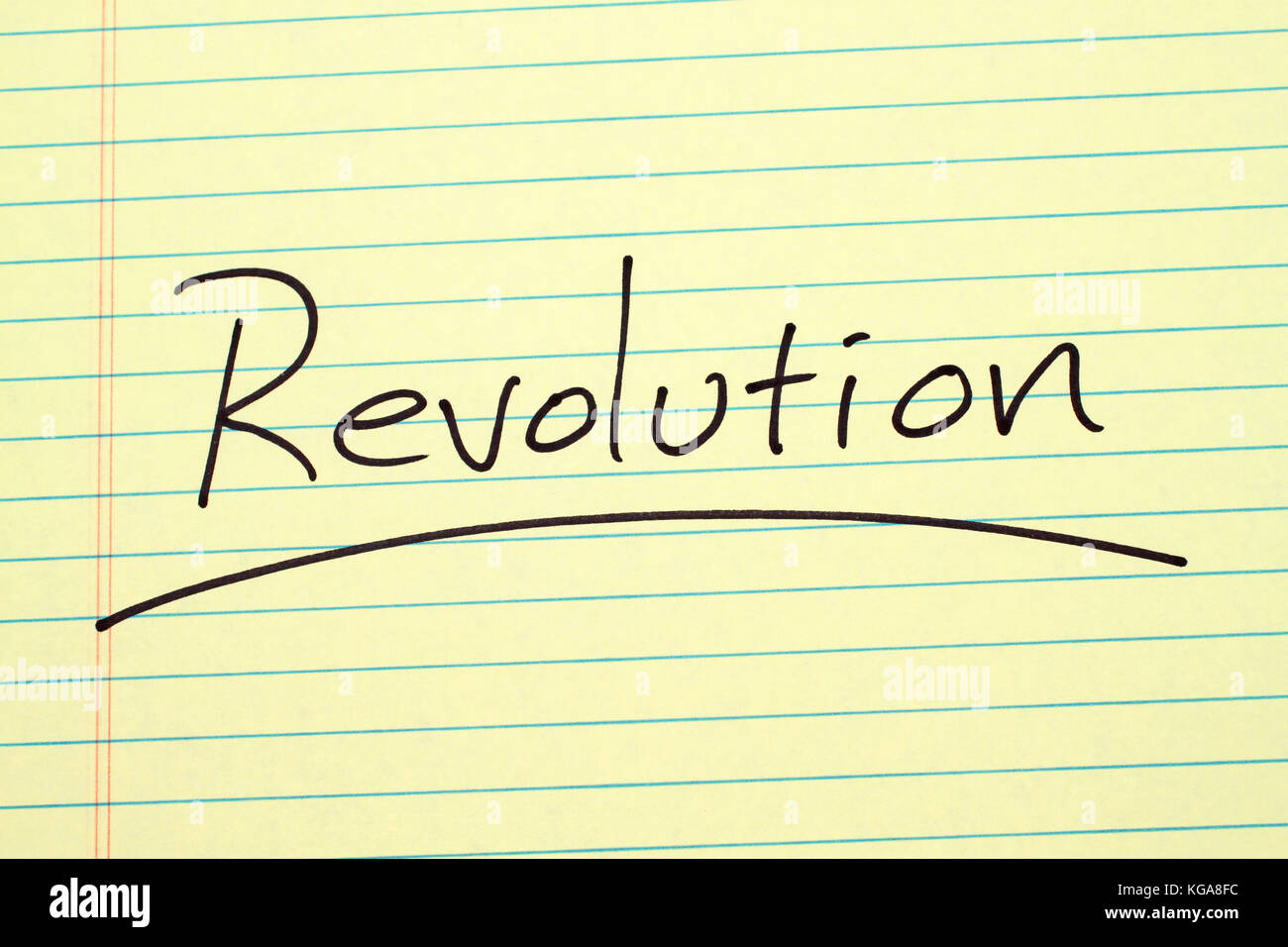 The word 'Revolution' underlined on a yellow legal pad - Stock Image