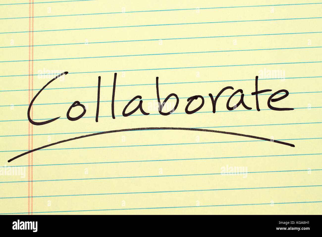 The word 'Collaborate' underlined on a yellow legal pad - Stock Image