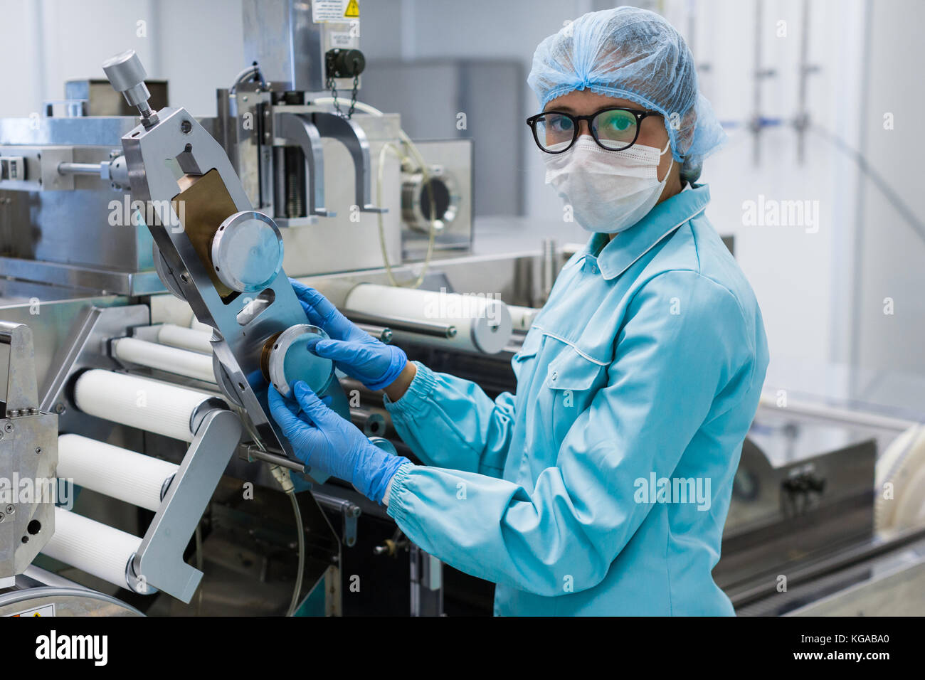 food technician works in a factory - Stock Image