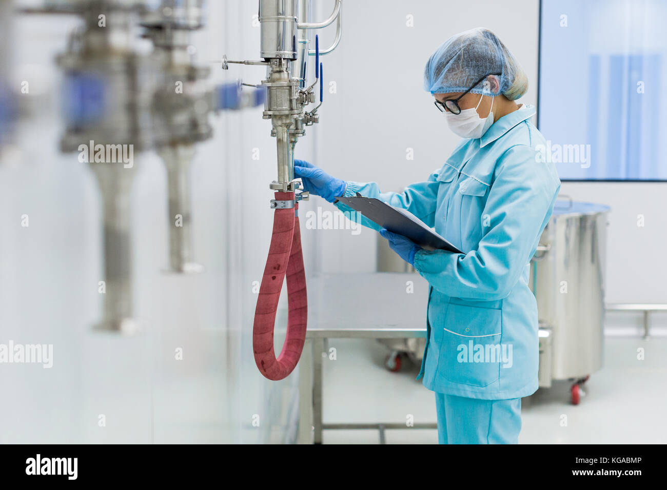 scientist is working with pressure meter in lab - Stock Image