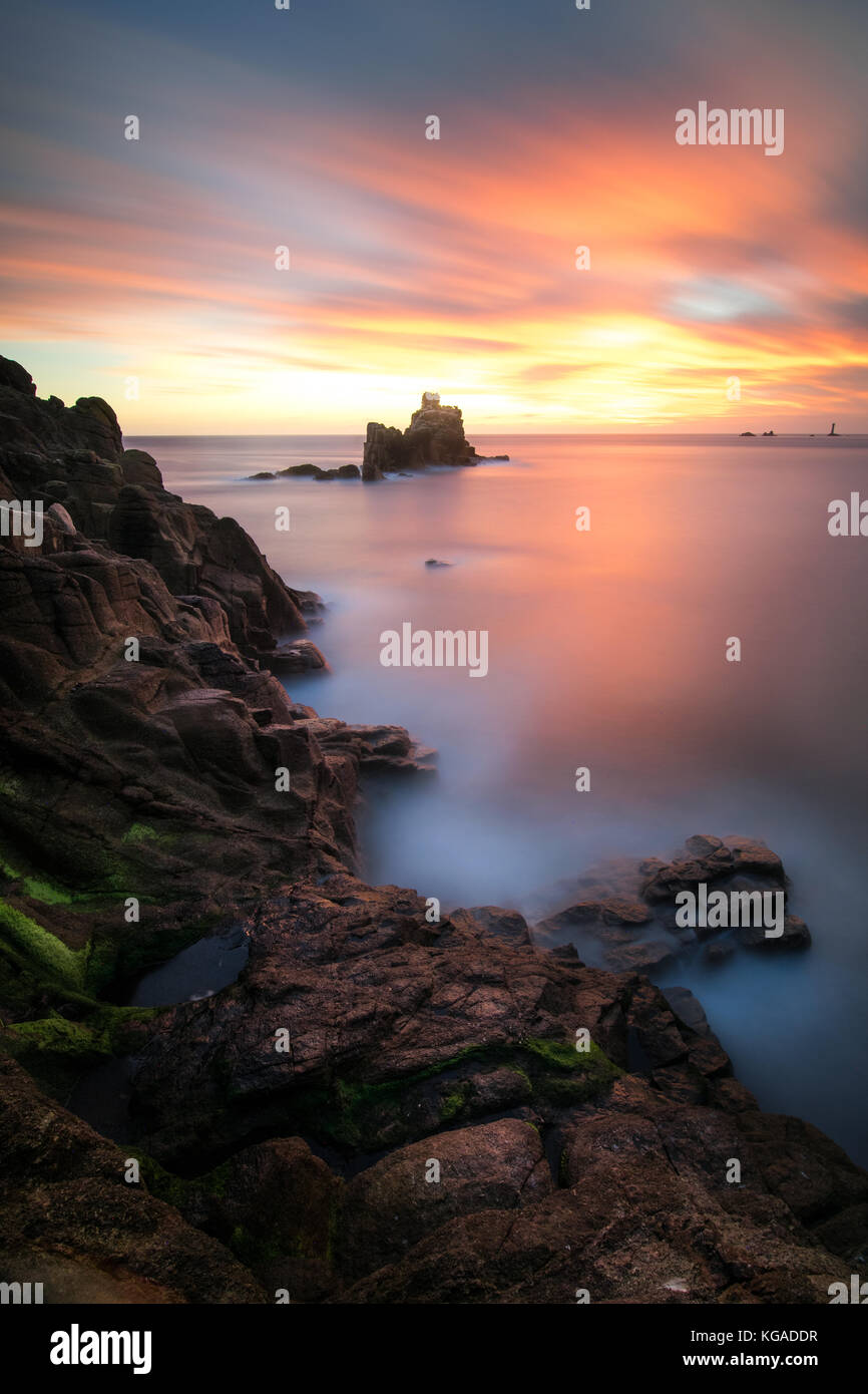 Landscape / seascape photograph sunset over the Armed knight, near Land's End in Cornwall. Stock Photo