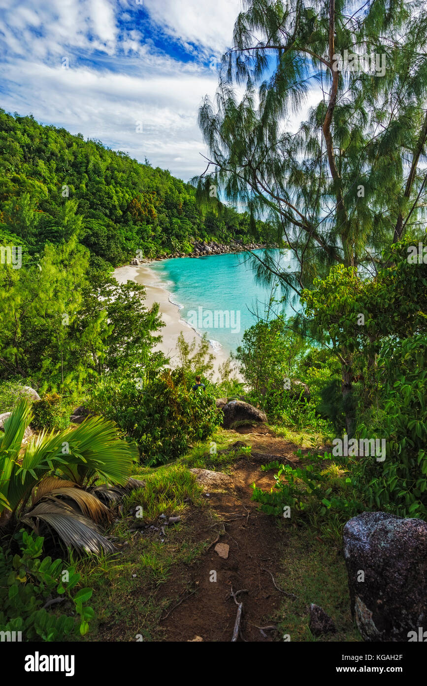 Hiking throug the jungle between the paradise beaches anse lazio and anse georgette, praslin, seychelles. Panorama Stock Photo