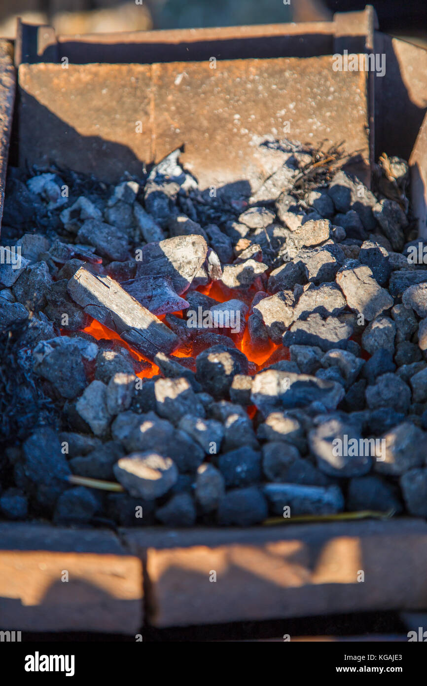 Burning charcoal ready for forging iron. - Stock Image