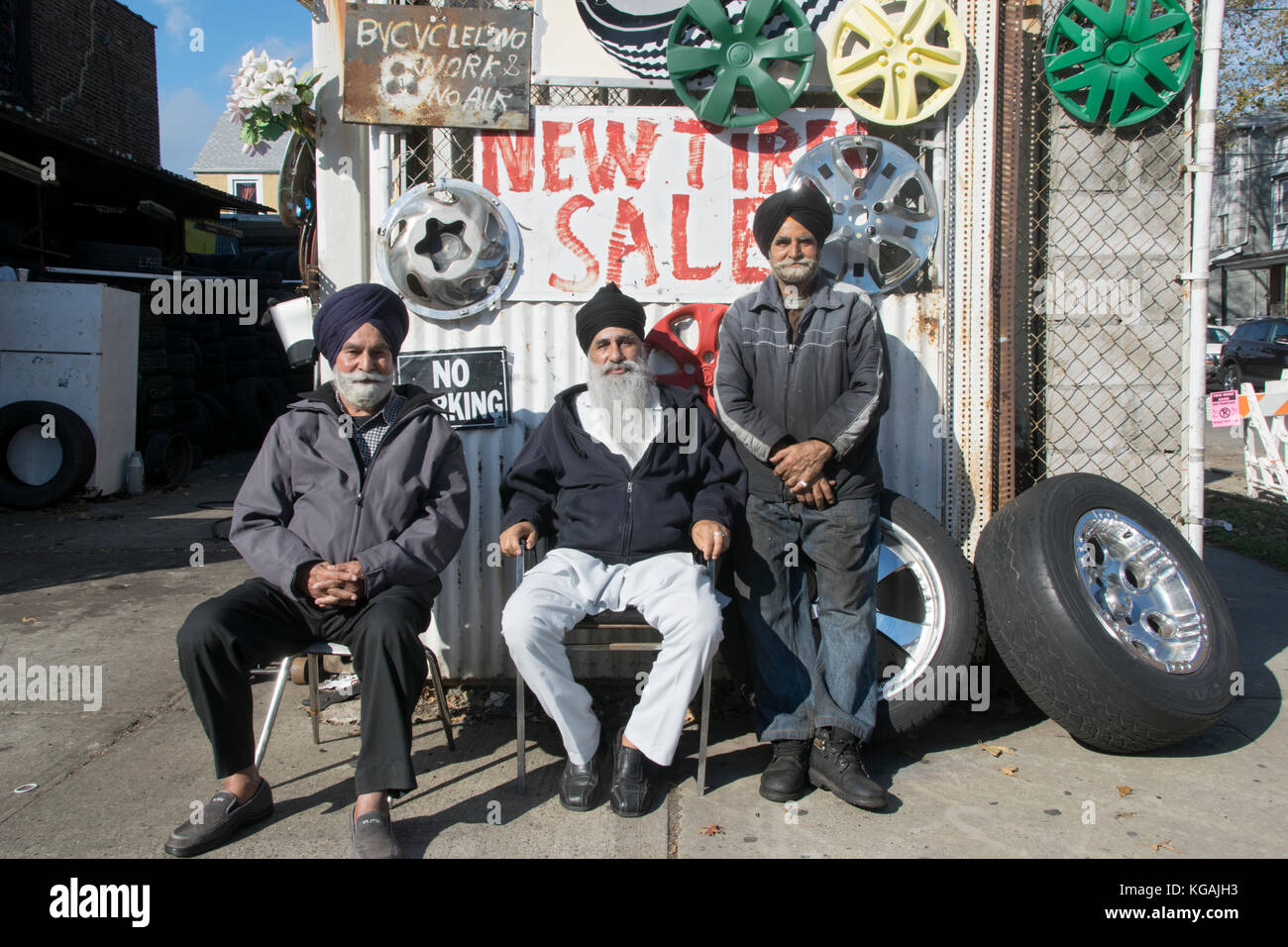 A  posed portrait of 3 Sikh Indian workers at the NY A-1 tire shop on 101st Avenue in Richmond Hill, Queens, New - Stock Image