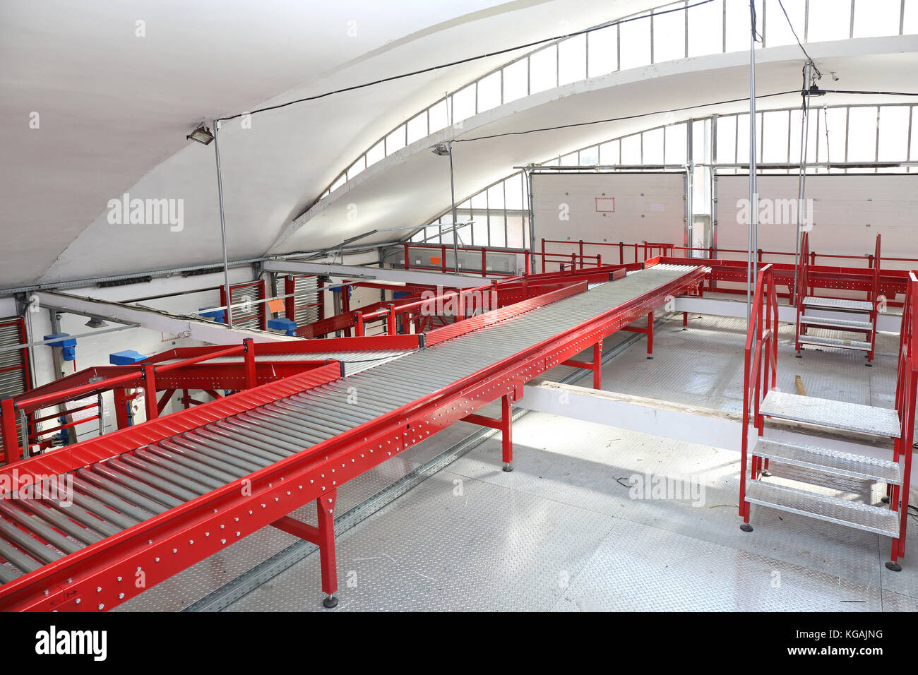 Long Conveyor Belt in Distribution and Delivery Warehouse - Stock Image