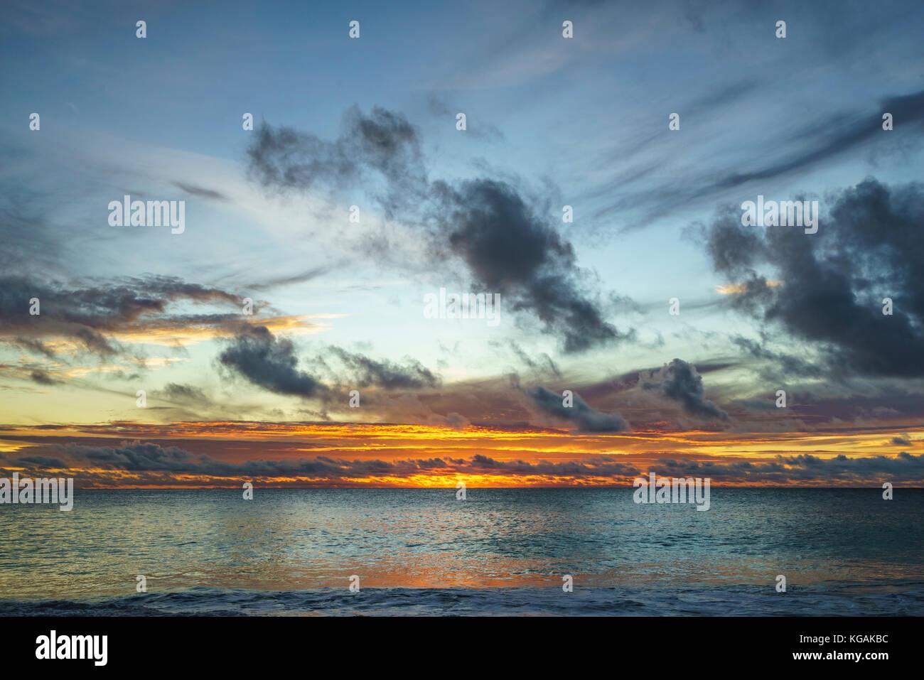 beautiful glowing romantic sunset on paradise beach at anse georgette, praslin, seychelles Stock Photo