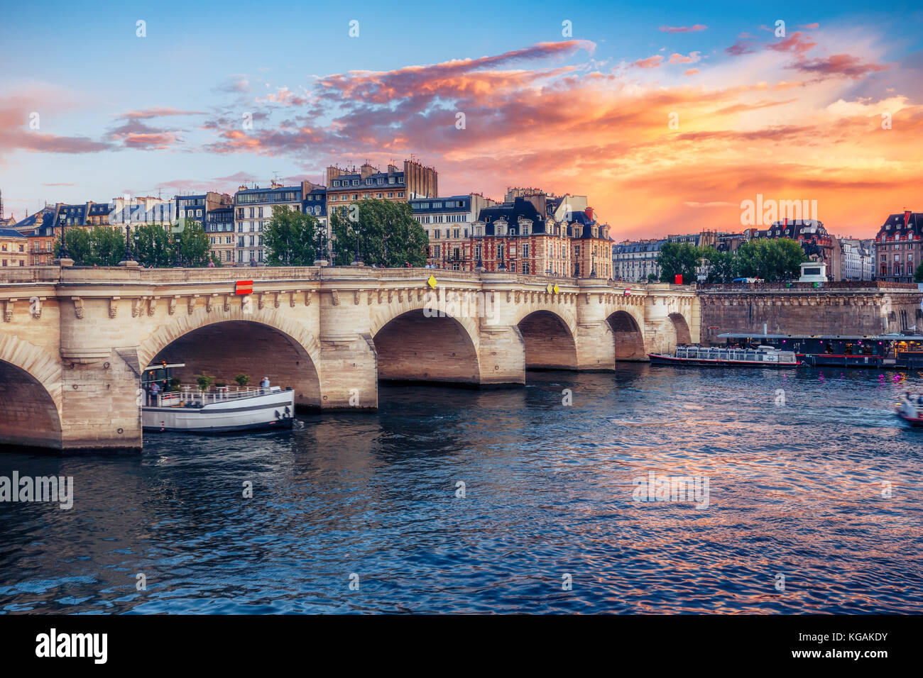 Famous Pont Neuf in Paris, France. Spectacular cityscape with dramatic sunset sky. Travel background. - Stock Image