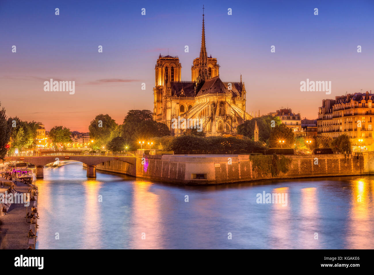 Notre Dame cathedral in Paris, France at night. Scenic skyline at blue hour. - Stock Image