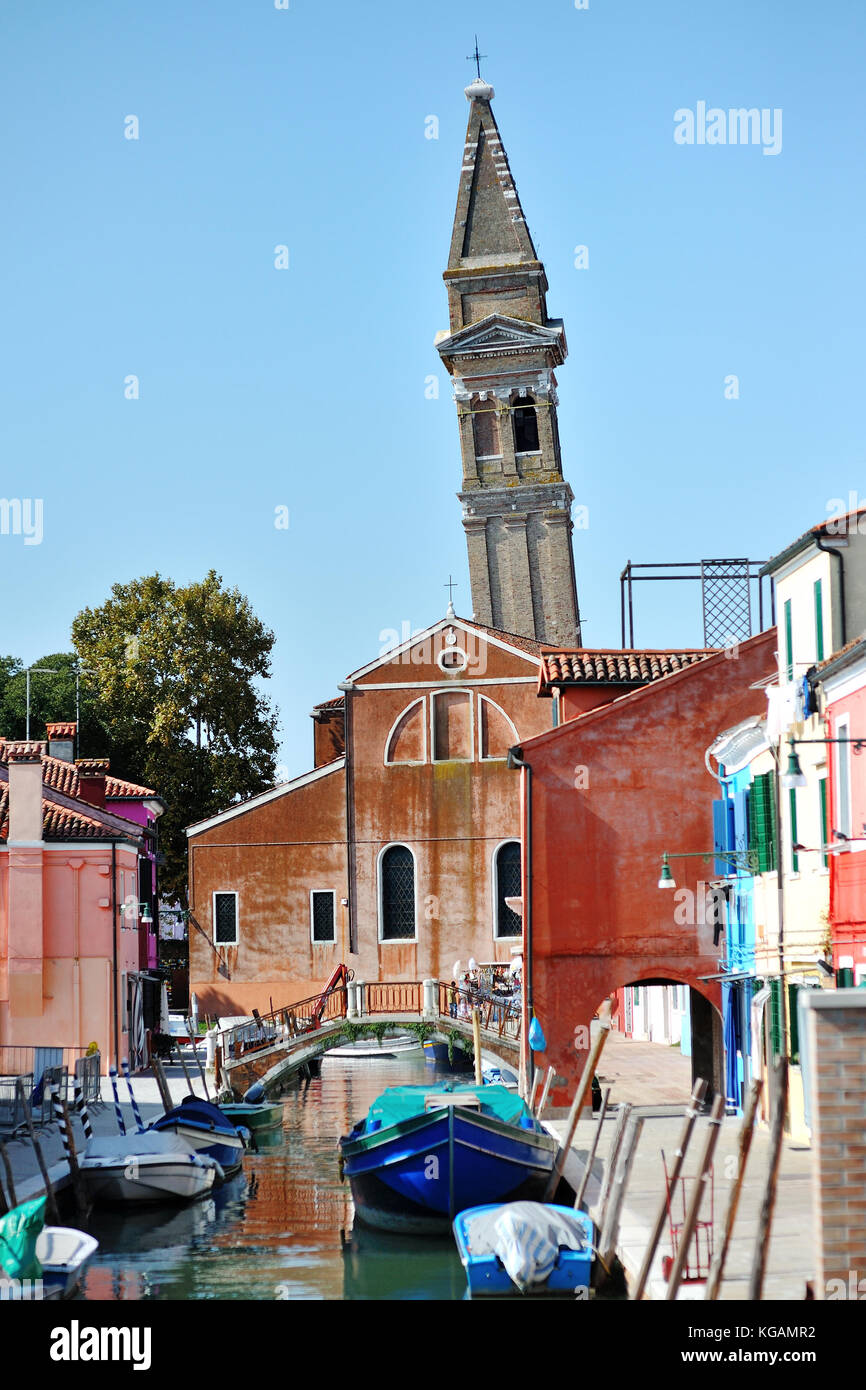 Burano island, Venice, Italy - scenic view of the canal and the leaning bell tower - Stock Image