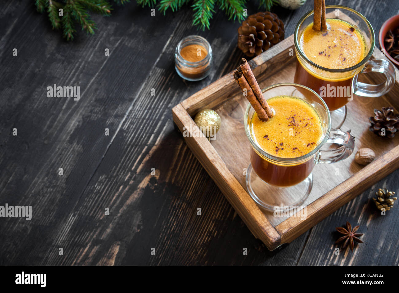 Hot buttered rum cocktail with cinnamon for Christmas and winter holidays. Homemade festive hot Christmas drink. - Stock Image