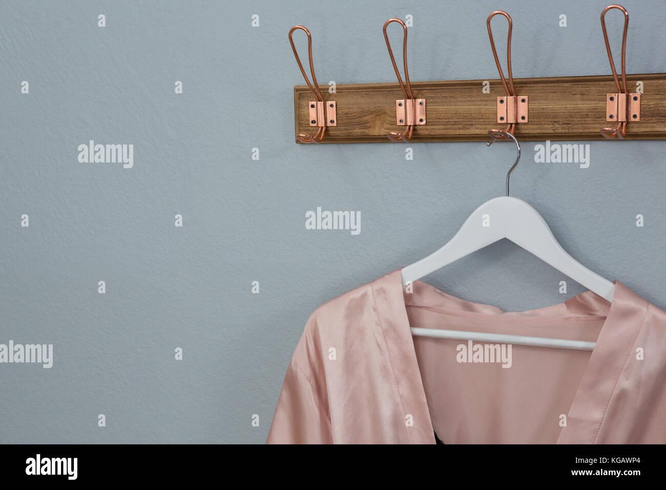 Close-up of nightwear hanging on hook Stock Photo