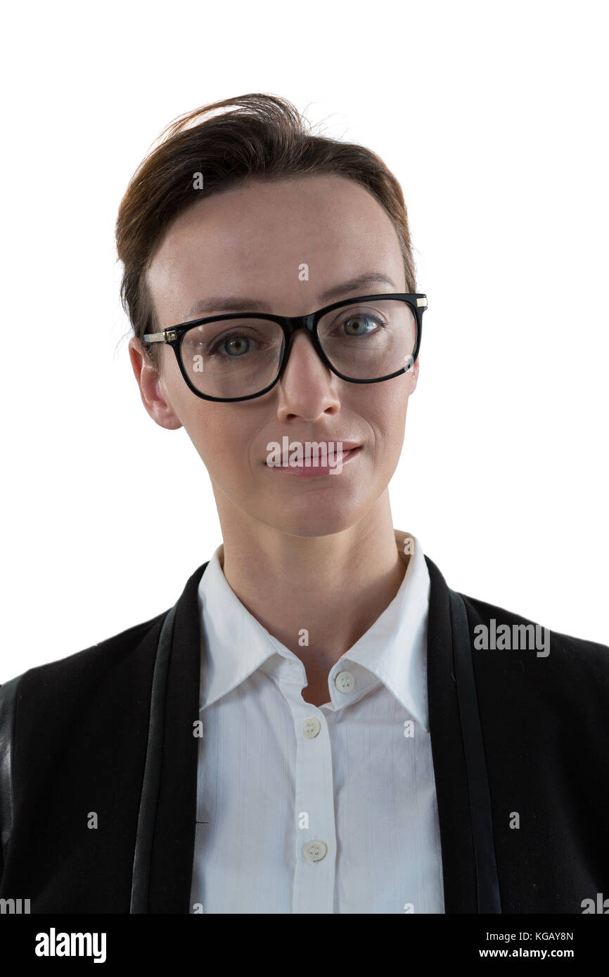 Portrait of businesswoman in spectacle against white background - Stock Image