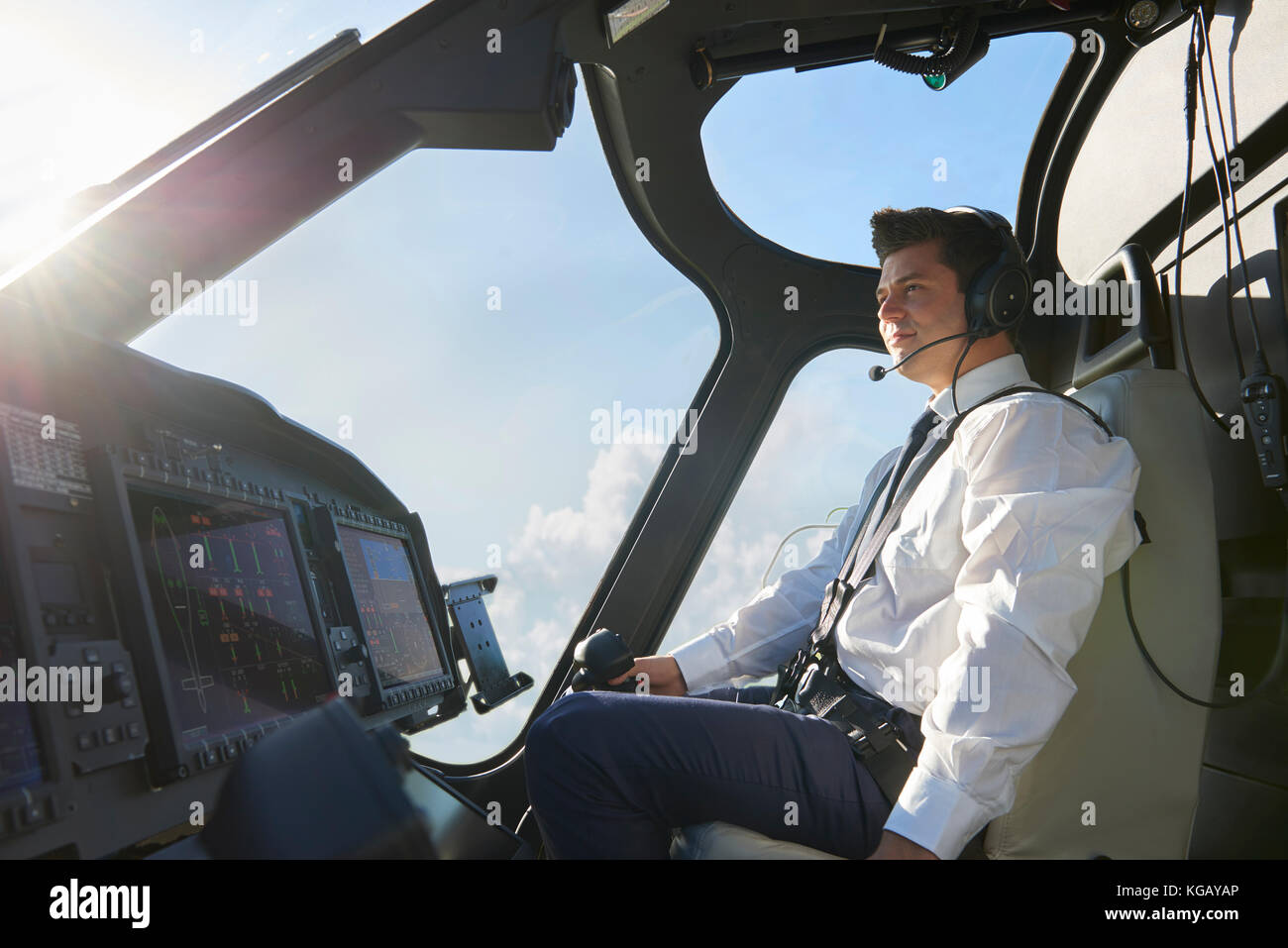 Pilot In Cockpit Of Helicopter During Flight - Stock Image