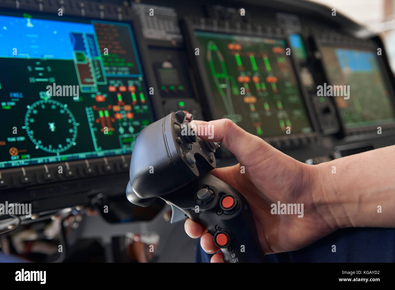 Close Up Pilot Holding Joystick In Helicopter Cockpit - Stock Image