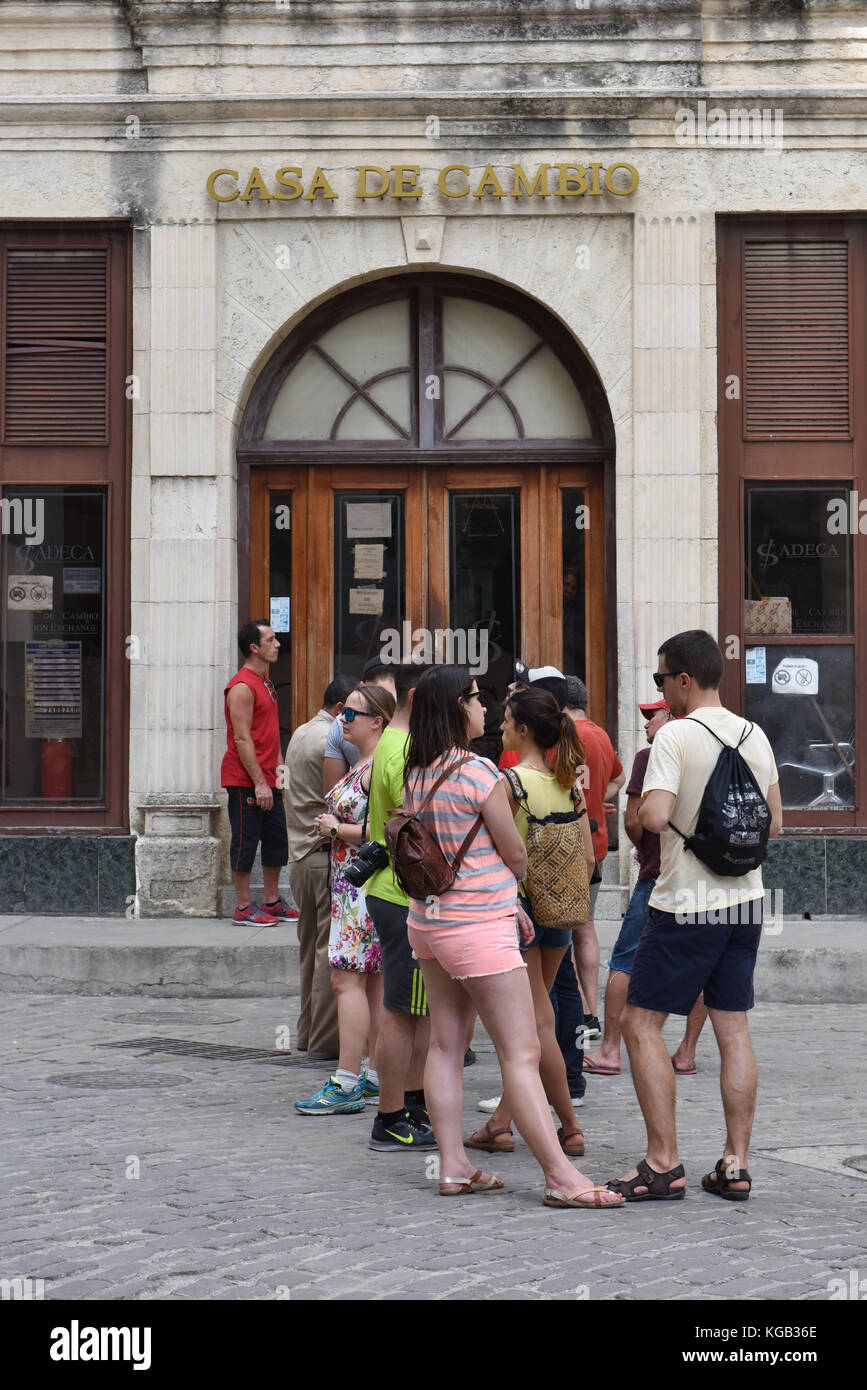Foreigners in front of a Money exchange Habana Vieja Cuba - Stock Image