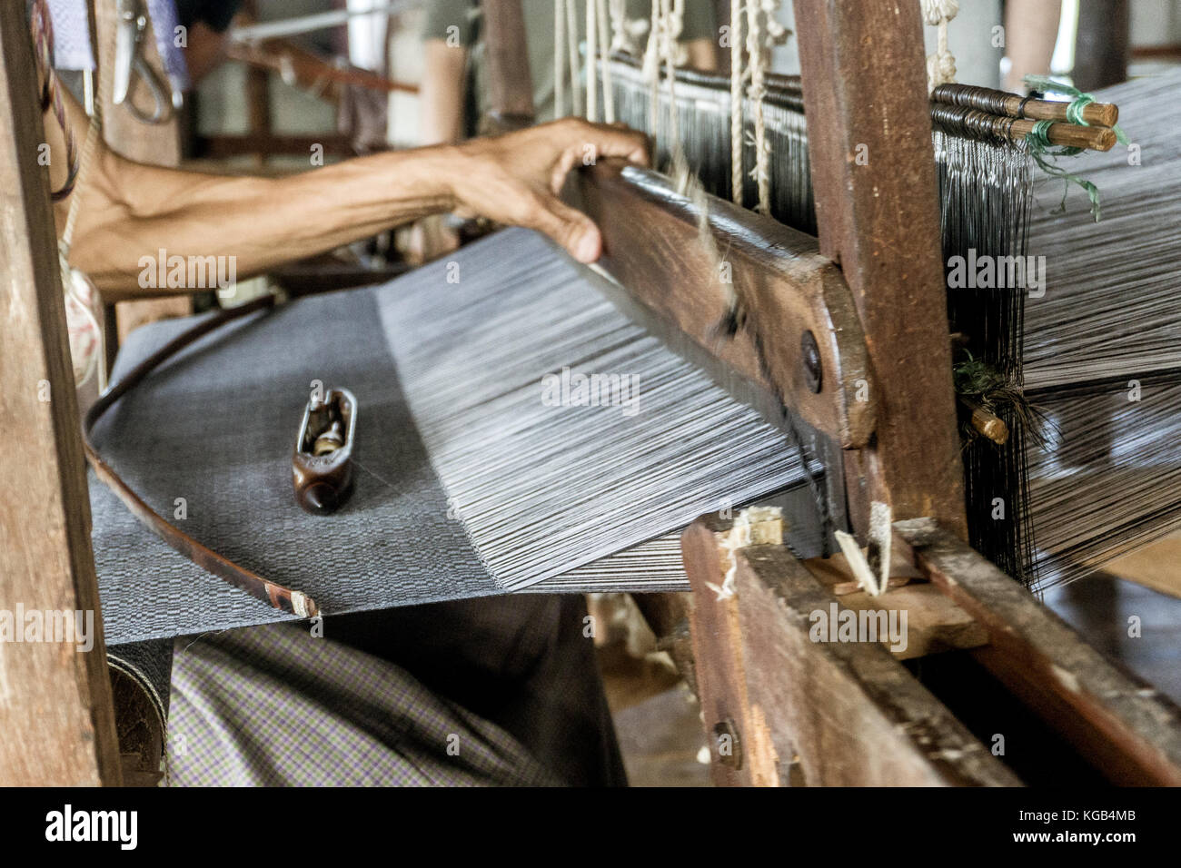 Day trip on Inle Lake - hand weaving factory - Stock Image
