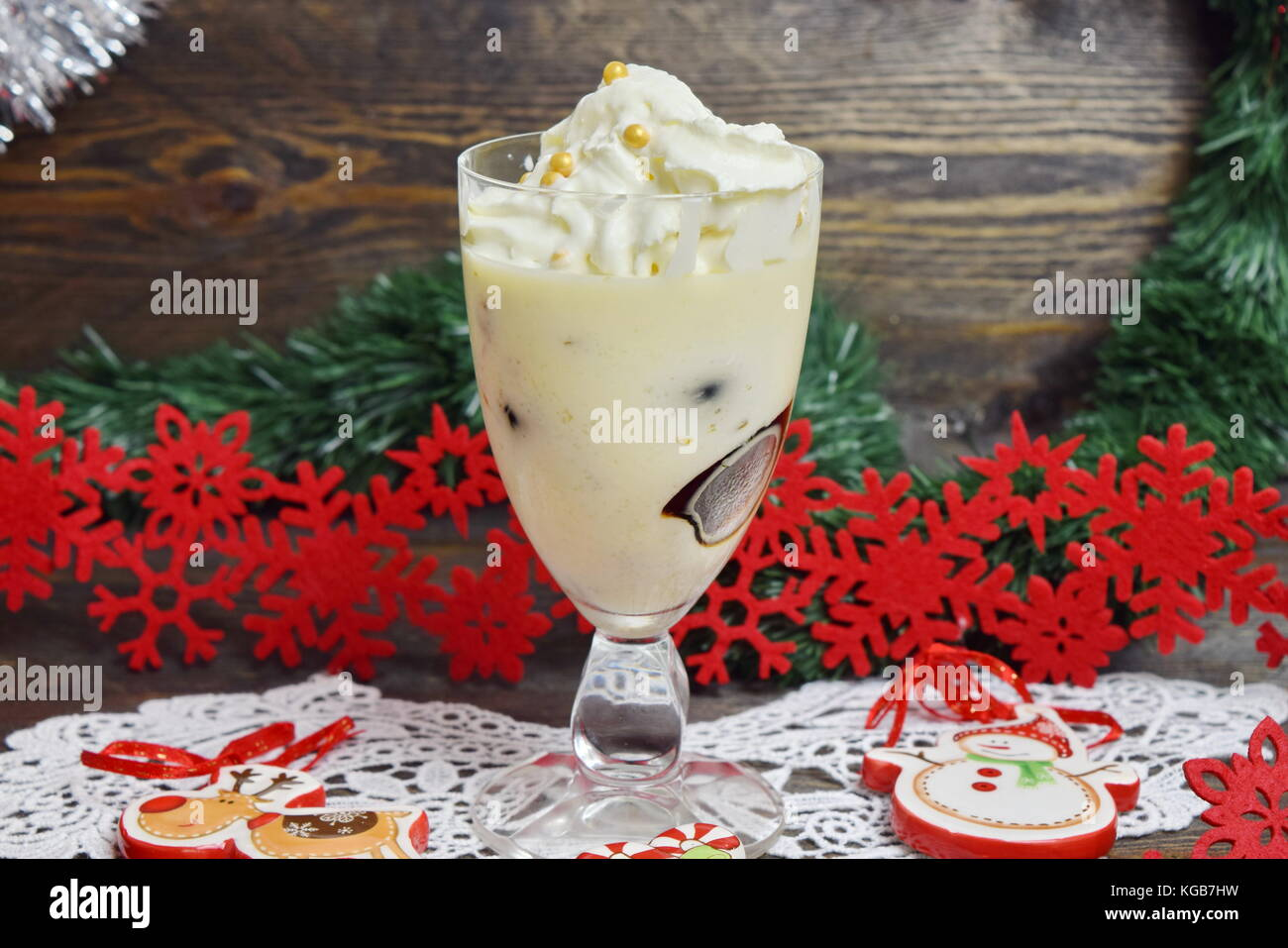 Dessert with Irish liqueur jelly cubes with whipped cream in a glass. Christmas and New year concept Stock Photo