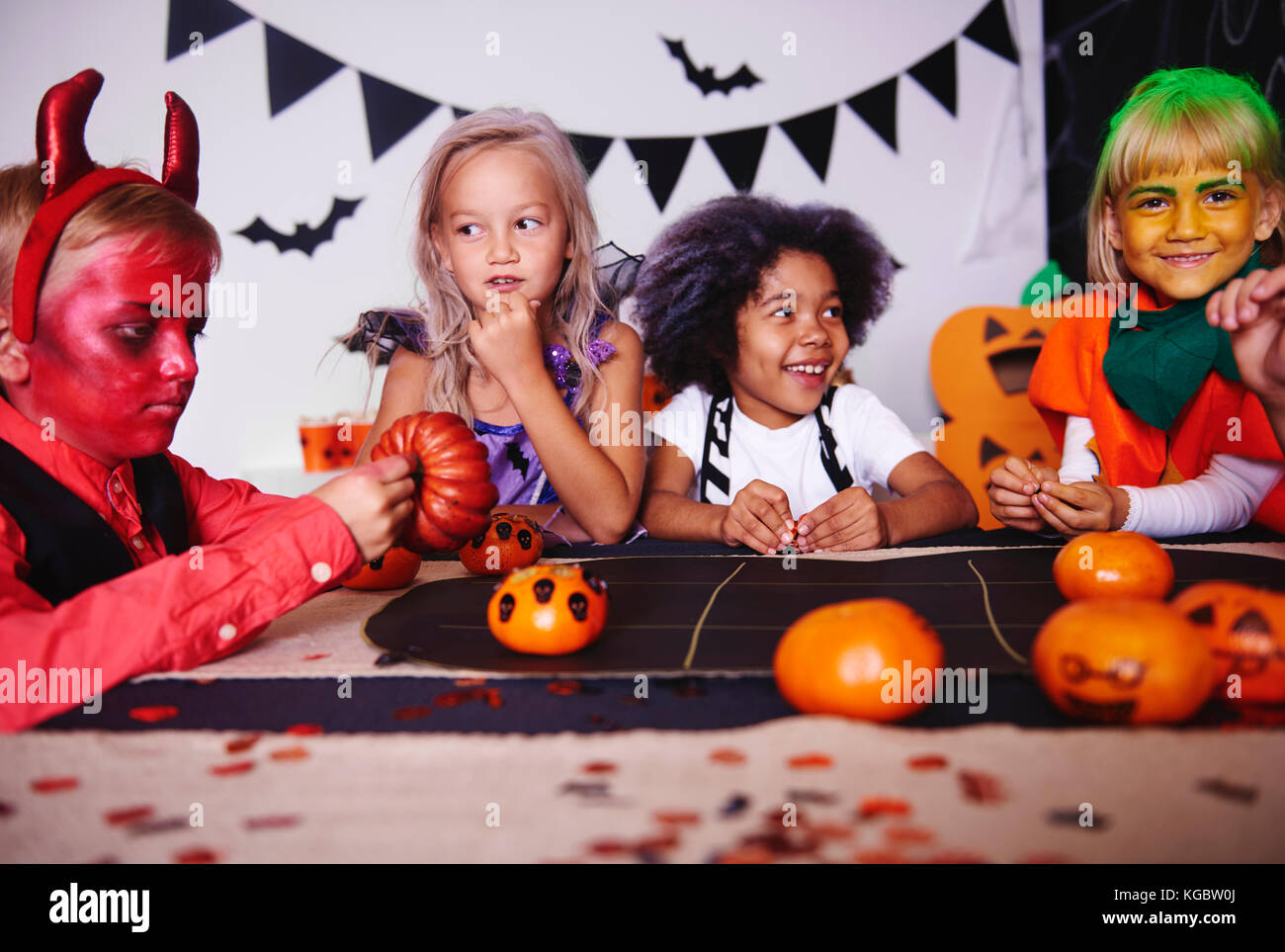 Children playing in costume at halloween party - Stock Image