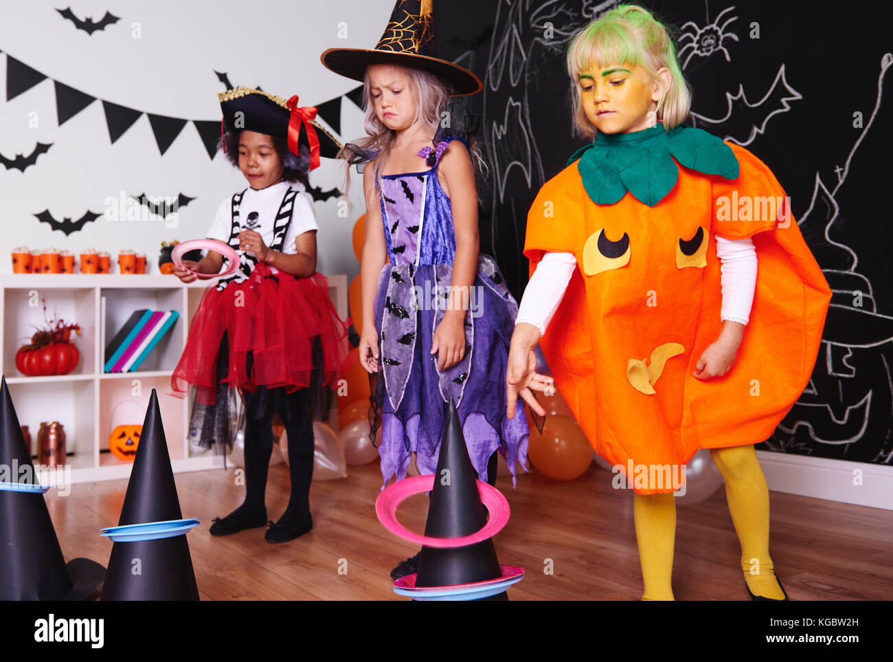 Children actively spending time at Halloween party - Stock Image