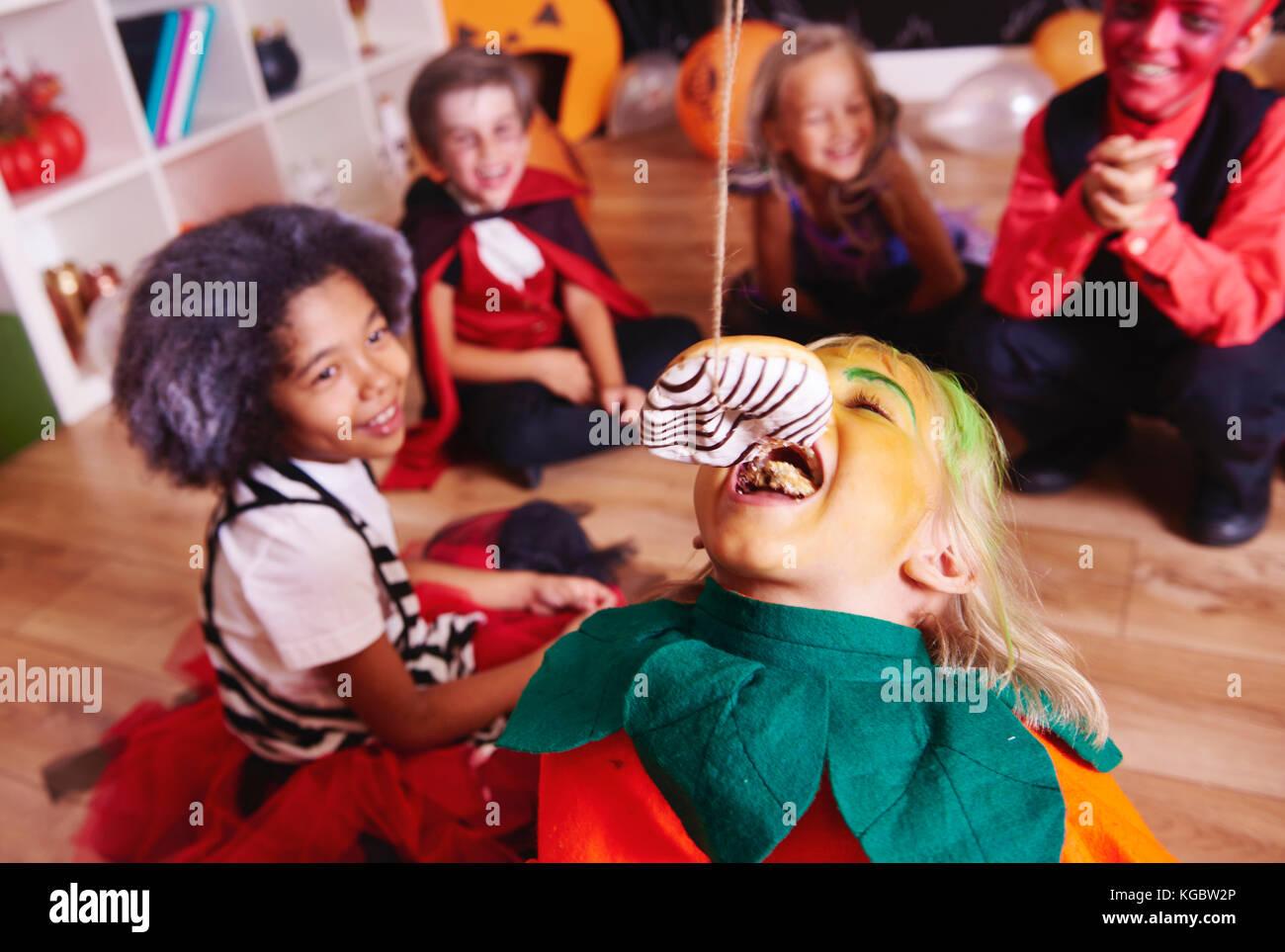 Children enjoying at halloween party - Stock Image