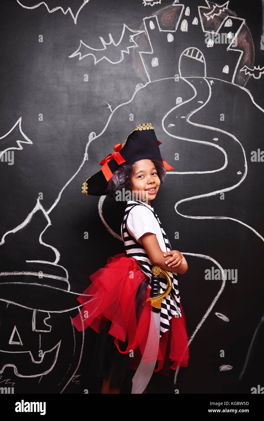 Mixed race girl in pirate costume - Stock Image