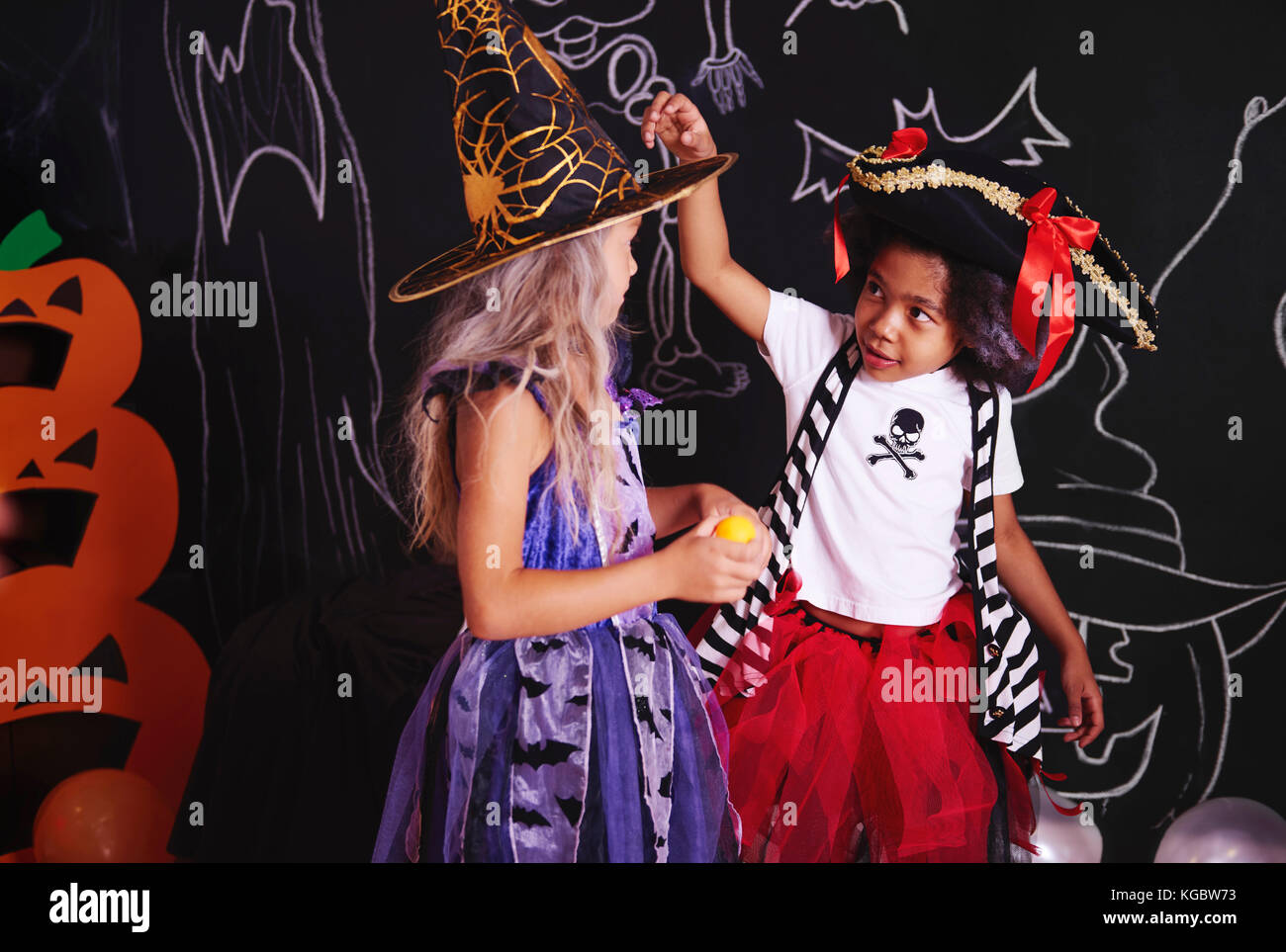 Two girls spending time together at halloween party - Stock Image