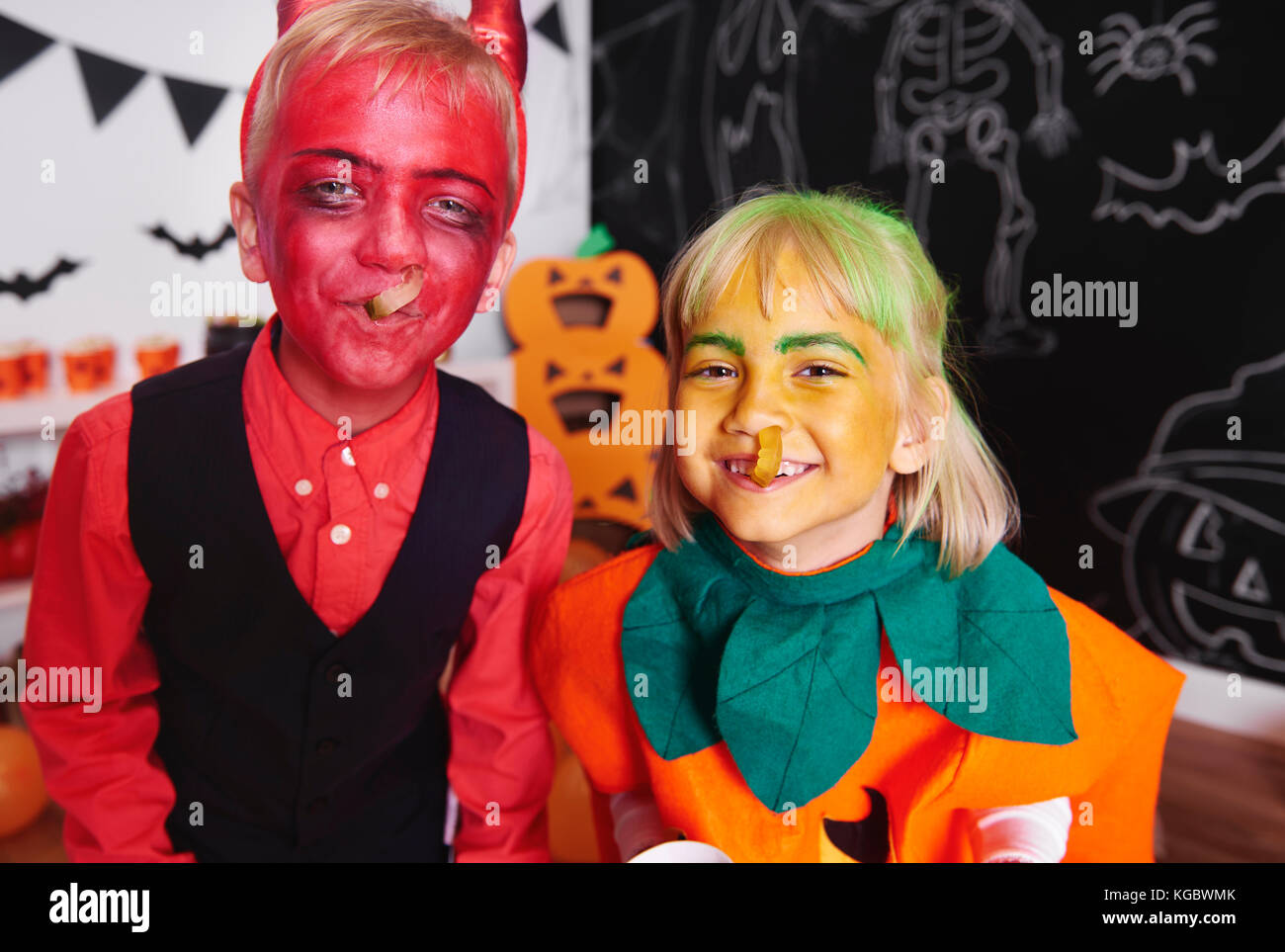 Siblings having a fun with gummy worms - Stock Image