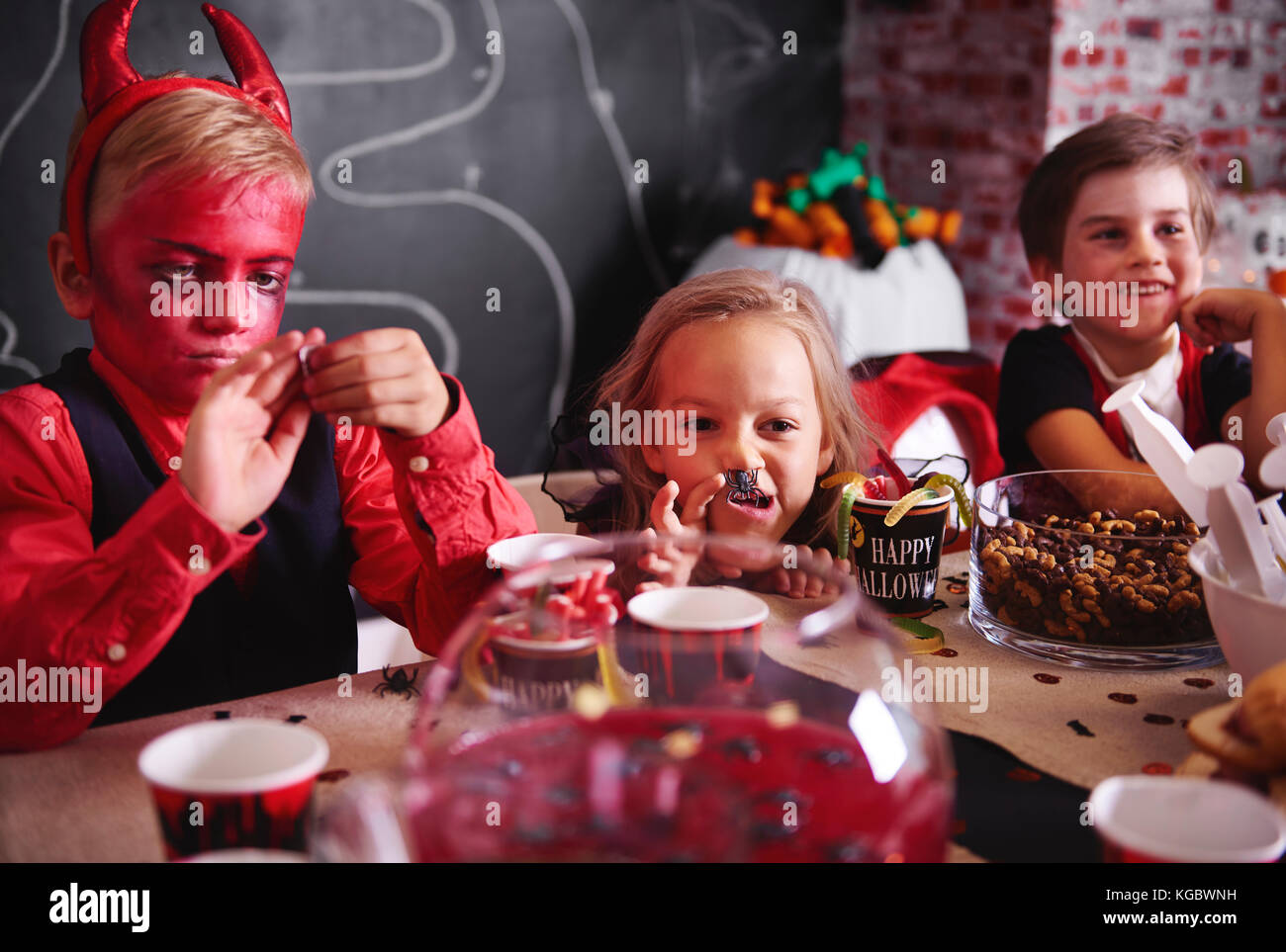 Nonsense while eating at halloween party - Stock Image
