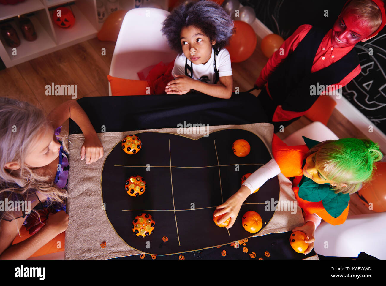 Kids spending time together while party game - Stock Image