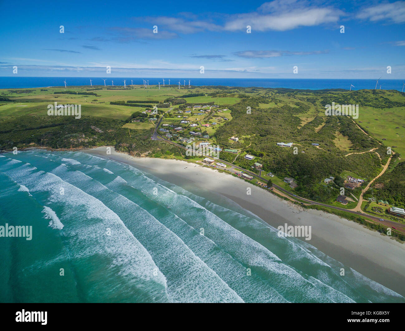 Aerial view of Cape Bridgewater beach, settlement, and wind farm in Victoria, Australia - Stock Image