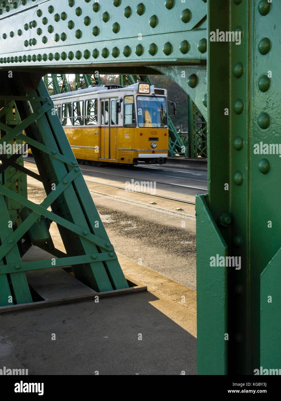 Tram passing Liberty Bridge in Budapest, Hungary Stock Photo