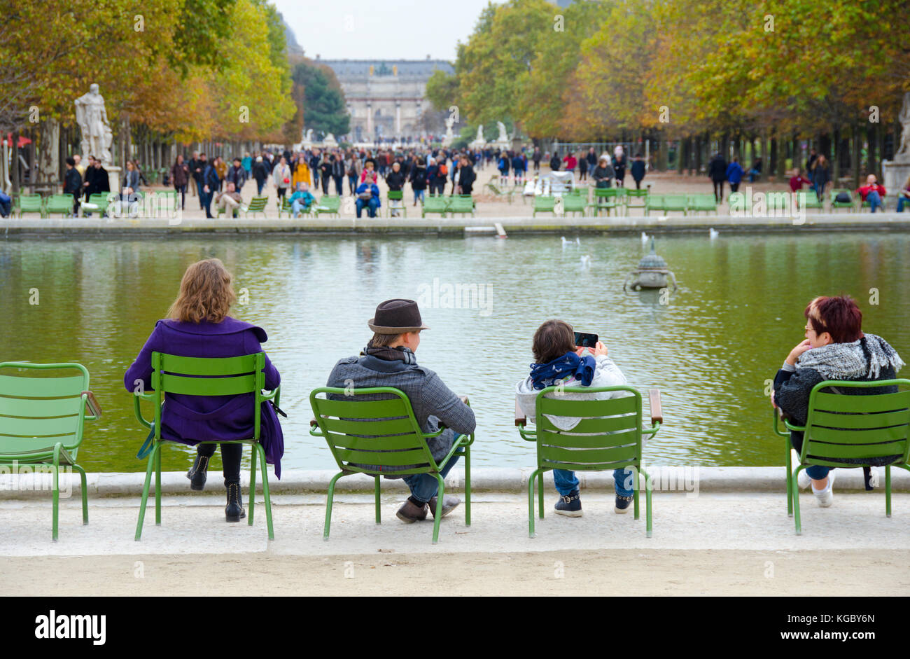 Paris, France. Jardin des Tuileries. Autumn - people sitting around the Bassin Octagonal (pond) - Stock Image