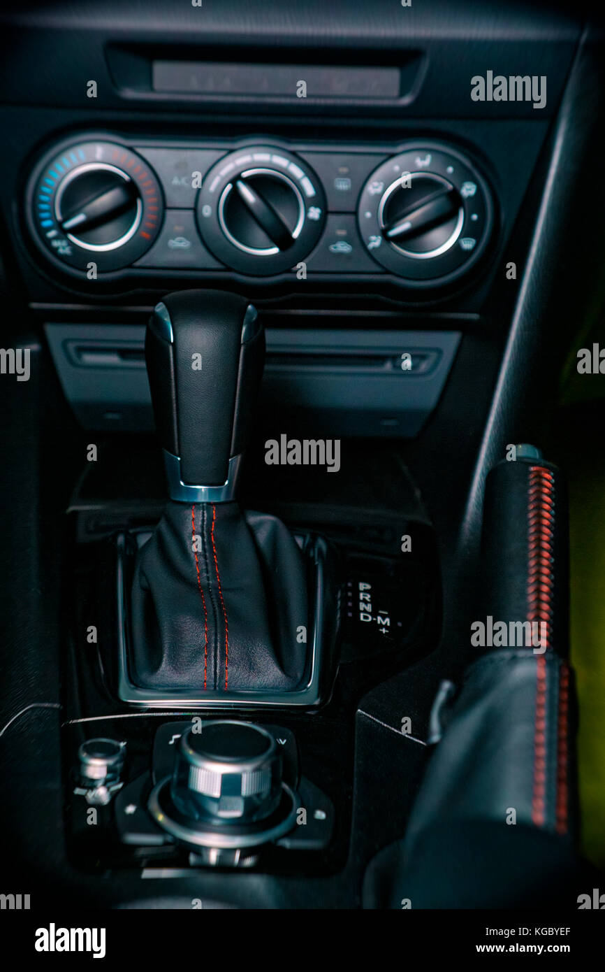Gear stick, handbrake and air conditioning and music player controls