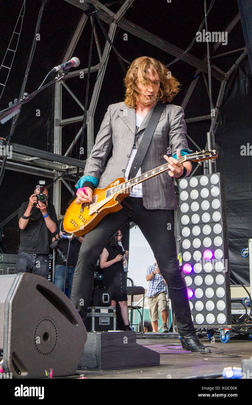 Dan Hawkins, lead guitarist of The Darkness, performs at Godiva Festival, Coventry, United Kingdom. - Stock Image