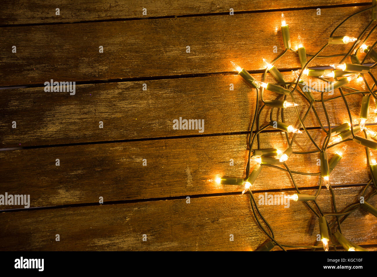 quality design 215e2 2cbe1 Christmas / New Year fairy lights on a wooden table to be ...