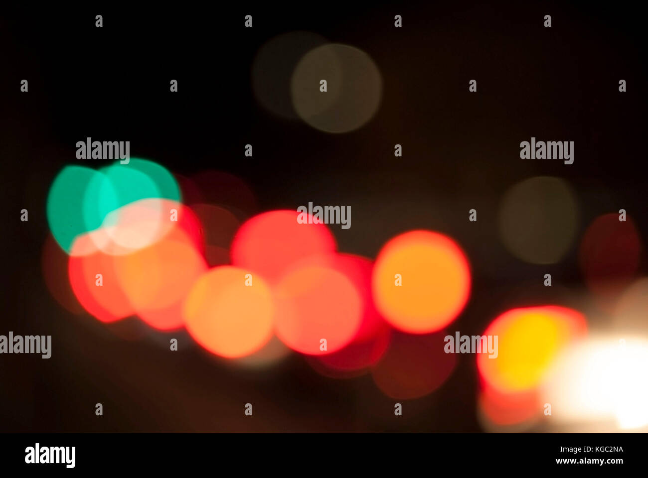 Unfocused car lights with dark background - Stock Image