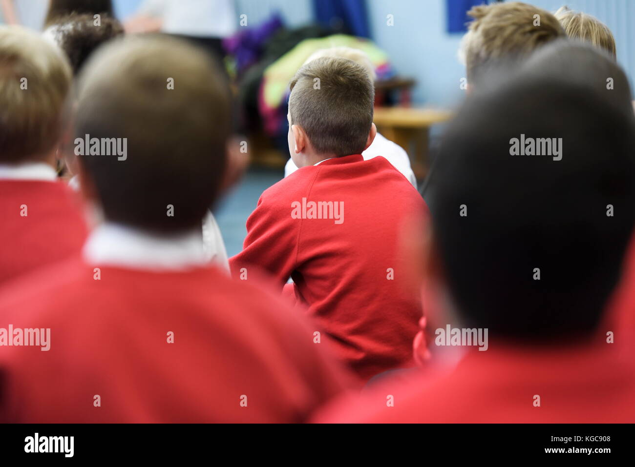 Group of School Children sitting in Assembly in a UK Primary School - Stock Image