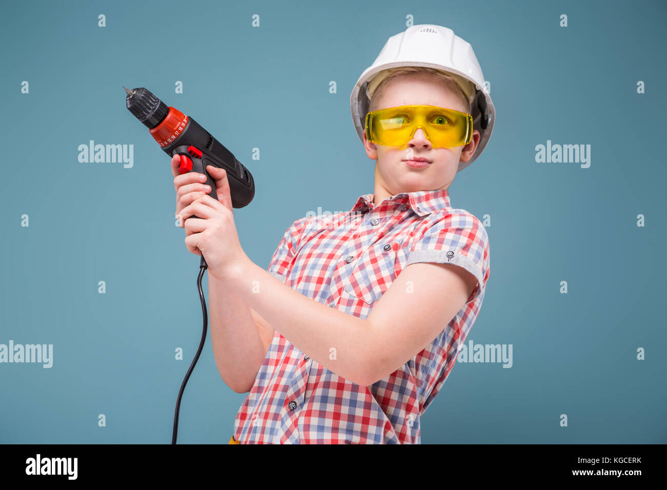 bewildered teenager with a screwdriver in the hands of uncontrollable - Stock Image