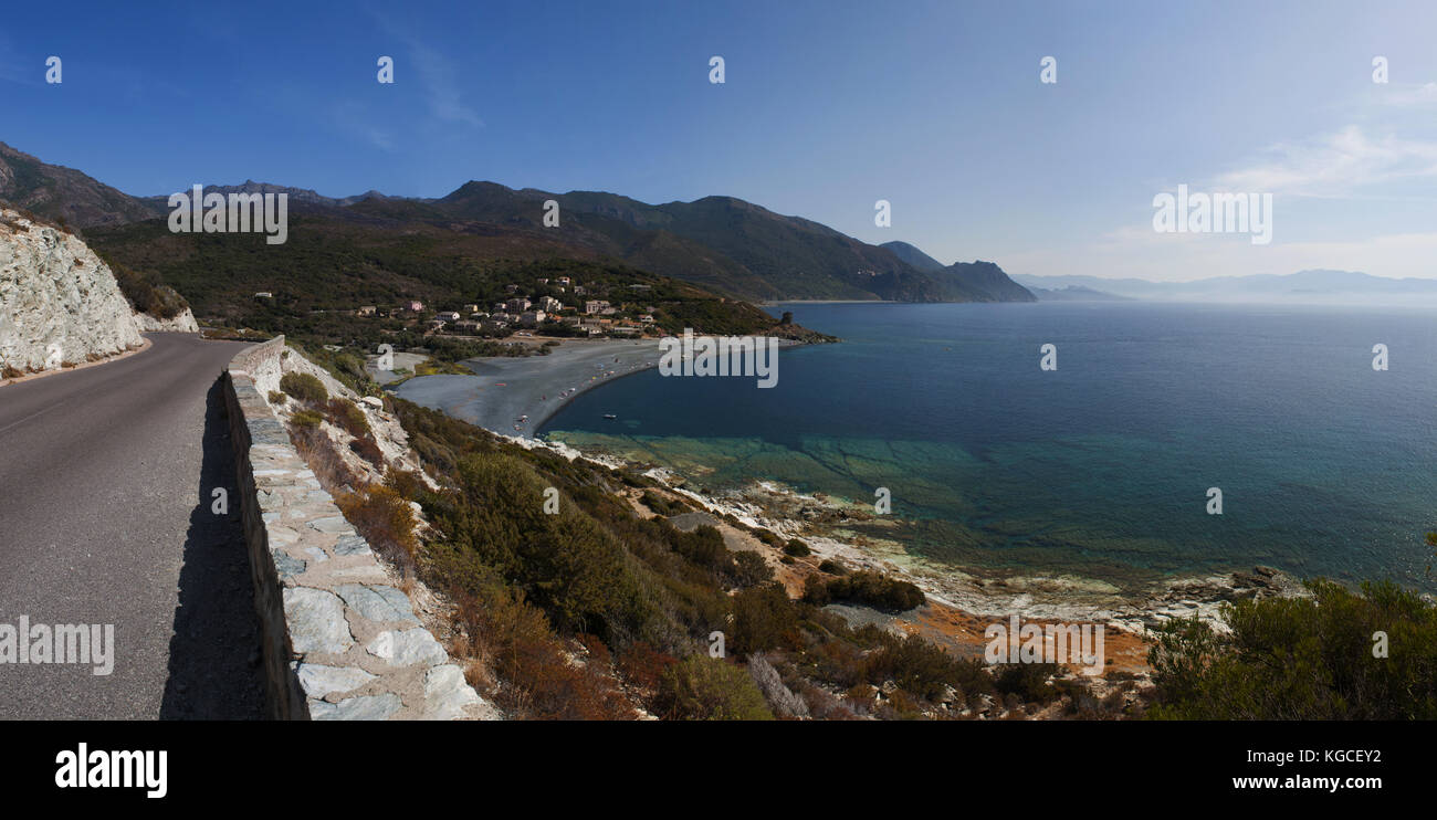 Corsica, Cap Corse: winding road of the western coast of the Cap Corse with view of one of the many black beaches Stock Photo