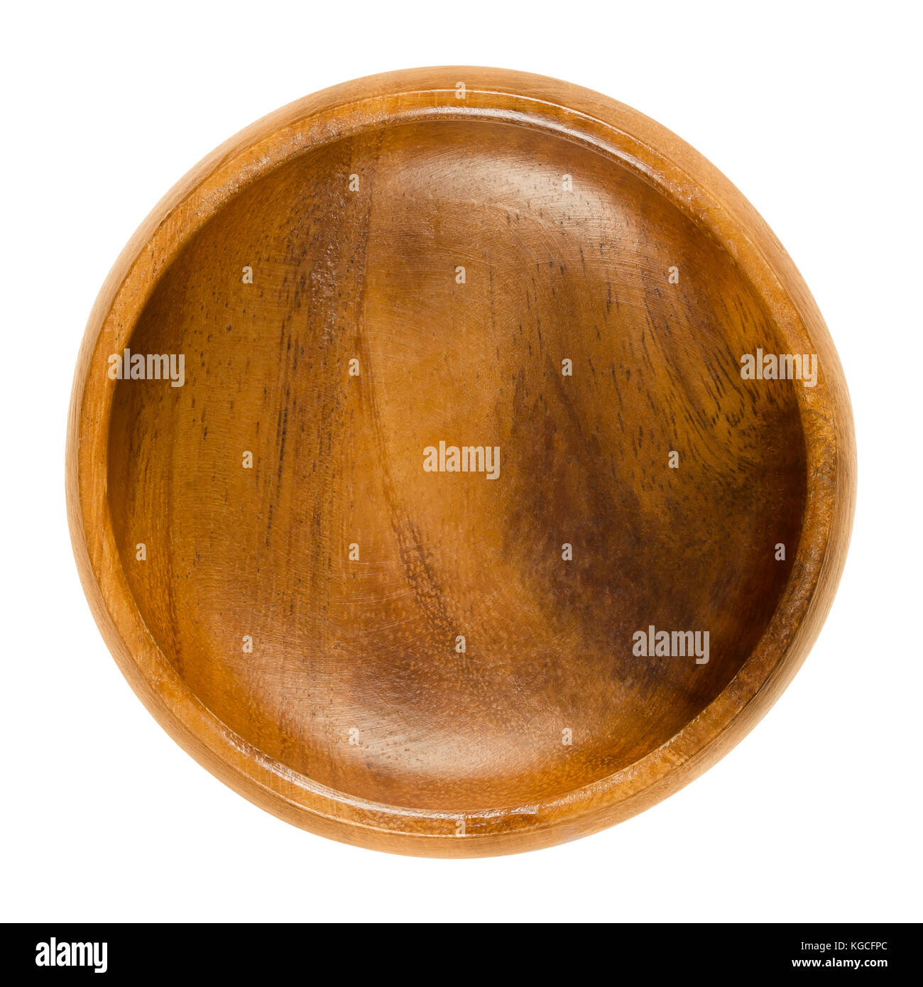 Empty wooden bowl. Small brown bowl with wood grain in simple design. Round open-top container for storing food - Stock Image
